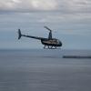 R44 in flight over sea