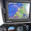 R44 cockpit GPS showing St Mawgan